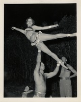 Sue Herndon Being Lifted By Gail Porter with Dutch Martin Observing