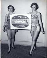 Sue Herndon and Faye Allen Posing with an Advertisement