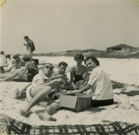 Bill Smith, Carol Rogers, and Friends Having a Beach Picnic