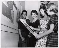 Florida State University Fashion Institute students holding design sketch in classroom