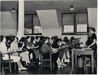 Florida State College for Women students listening to instructor and taking notes in class