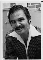 Actor Burt Reynolds dressed in checked sport jacket
