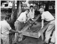 Four men sifting for artifacts
