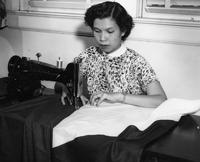 Female student sewing a flag