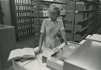 Woman making copies in the library