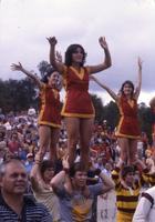 Cheerleaders standing on shoulders