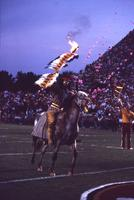 Osceola riding renegade with flaming spear