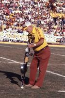 Man with device on football field