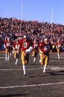 Players running onto the field