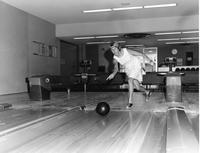 Unidentified female student bowling