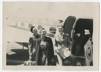 Three women next to an airplane