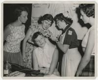 Student nurse examining members of 4-H Club