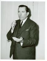 Claude Pepper gesturing in a three-piece suit