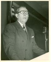 Claude Pepper at a microphone