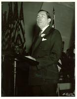 Claude Pepper at a podium giving speech at the All Chicago Flag Day Celebration