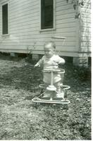 Baby playing in yard