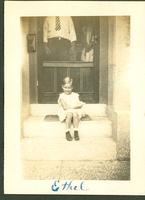 Young girl on front steps