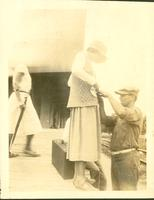 Woman on a platform with a man in uniform