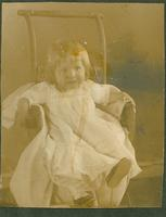 Young girl in chair