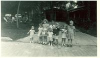 Several children standing in driveway