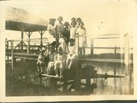 Several children on a dock