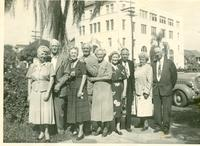 Thomas and Irene Webster with group posing on a sidewalk