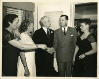 Thomas and Irene Webster talking to a couple