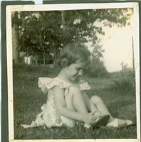 Young girl sitting on lawn
