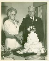 Thomas and Irene Webster cutting their anniversary cake