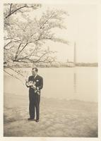 Claude Pepper admiring cherry blossoms in front of the Washington Monument