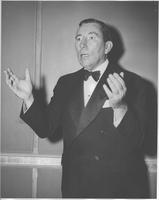 Claude Pepper gesturing in a dress suit