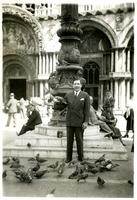 Claude Pepper feeding the pigeons in the piazza of San Marco
