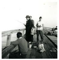 Claude Pepper fishing off of a pier