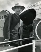 Claude Pepper boarding an airplane