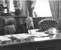 Claude Pepper at desk in the Rules Committee office