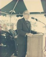 Claude Pepper at a podium in a tent giving a speech