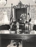 Claude Pepper at a desk in his Rules Committee office