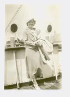 Unidentified woman standing onboard a ship
