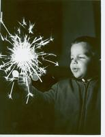 Andrew Beavers Burk with sparkler