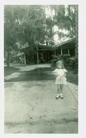 Young girl in a driveway