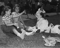 Children play with a clown