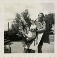 Two F Club Members in Costume Holding Goat