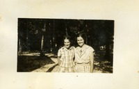 Betty and Frances Lewis Posing In Front of Trees