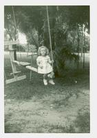 Young girl on a swing set