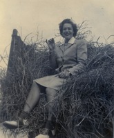Victoria Lewis Sitting on Pile of Hay
