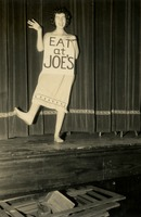 "Woman with ""Eat at Joe's"" Sign"