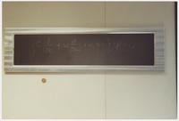 Color photograph of blackboard section on which Dirac Equation is written