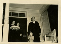Graduating Students Martha Twitty and Jere Turner on a Porch with Edward Conradi