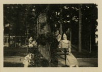 Ann Page, Eleanor Hope Miller, and Mary Clemants Sitting Behind a Tree