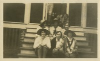 8 Women Sitting on Steps at Camp Flastacowo